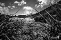 Il profilo della vetta si riflette sul calmo lago del Lauson, sotto l'Assietta